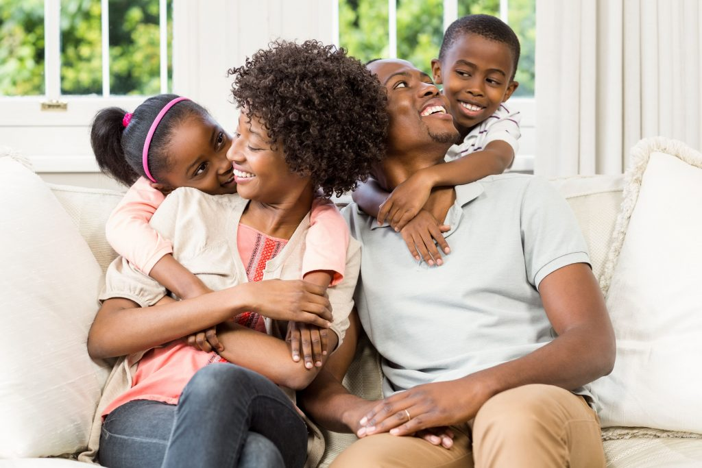 Happy African American Family in House